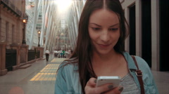 Interior shot of a woman texting on her phone Stock Footage