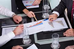 high angle view of businesspeople discussing plan in office - stock photo