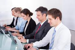 businessman with his colleagues - stock photo