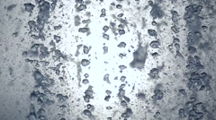 Water drops are pouring the background - stock footage