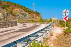 Asphalt road in a mountainous area with dangerous turns Stock Photos