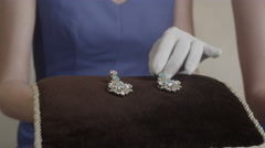 Jewellery treasure in pillow choice in the store Stock Footage