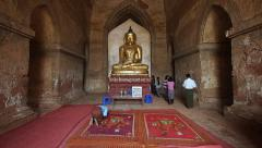 Man Bowing in Front of Ancient Buddhist Shrine in Bagan, Myanmar (Burma) Stock Footage
