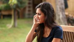 Mediterranean Woman Chatting on the Phone in the Garden Stock Footage