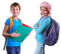 Pupils of grade school with backpack and books Stock Photos