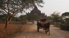 Carriage Exiting Dhammayangyi Temple in Bagan, Myanmar (Burma) Stock Footage