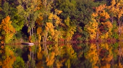 Autumn Colors, Trees Reflected in Calm, Flowing River Stock Footage