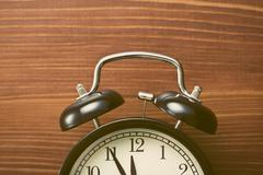 Closeup of analog retro alarm clock Stock Photos