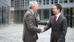 Business people happy to meet each other - stock footage
