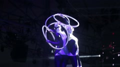 Two girls with glowing hoop dancing on stage Stock Footage