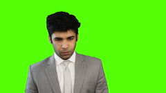 Locked-on shot of a young businessman giving presentation on green background Stock Footage