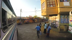 People on the street of Mirissa from moving bus. Stock Footage