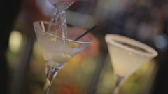 Close up of a bartender pouring a martini on the bar of a restaurant Stock Footage