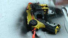 Toy gun being sprayed black Stock Footage