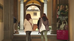 People walking into museum Stock Footage