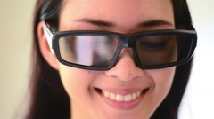 $Asian woman, close up of smiling face, girl with 3D glasses Stock Footage