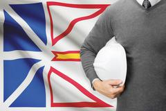 Engineer with flag on background series - newfoundland and labrador Stock Photos