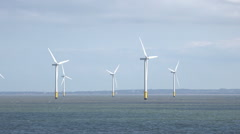 zoom out, wind turbines in liverpool bay, irish sea, england, uk - stock footage