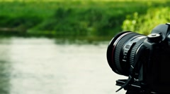 Dslr cam with river in background Stock Footage