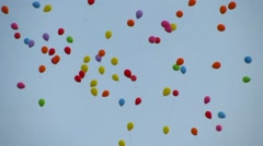 Closeup of various colorful balloons flying up to the sky Stock Footage