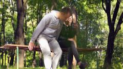 Young couple in a park acquaintance, meeting (1) Stock Footage