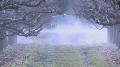 Fertiliser spreader orchard Stock Footage
