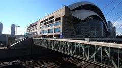 A passenger train passes the Rogers Center stadium, Toronto Stock Footage