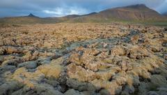 Never-ending Lava fields in Iceland with mountains - stock photo