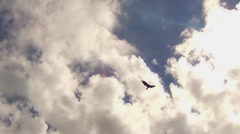 Lone Hawk Soaring Against Partly Cloudy Sky Stock Footage