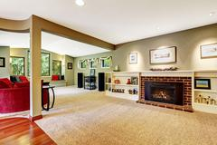 Living room with fireplace and decorated shelves Stock Photos