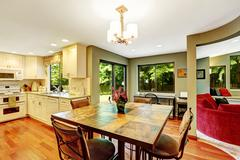 dining area in house with open floor plan - stock photo