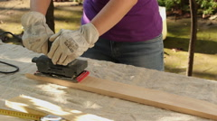 DIY - woman sanding wood plank Stock Footage