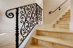 marble staircase with black wrought iron railing - stock photo
