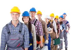 Large group of construction workers queuing up Stock Photos
