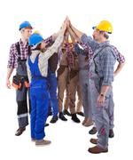 Multiethnic group of artisans doing a high five Stock Photos