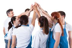 group of cleaners making high five gesture - stock photo