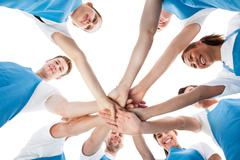group of cleaners stacking hands - stock photo