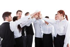 Catering staff making high five gesture Kuvituskuvat