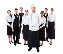 Chef standing in front of his team Kuvituskuvat