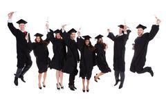 happy rejoicing group of multiethnic graduates - stock photo