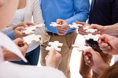 Group of people connecting puzzle pieces Stock Photos