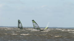 Windsurfers on a windy sea - stock footage