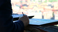 Old man painting close up Stock Footage