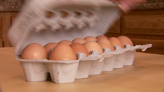 Choosing Egg from Carton - stock footage
