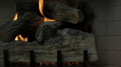 Logs in a gas fireplace (dolly) Stock Footage