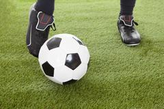 Low section of player's leg on soccer ball at playing field Kuvituskuvat