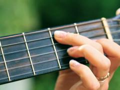 Woman hands showing guitar chords, steadycam shot Stock Footage
