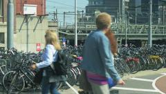 4K Commuters and parked bikes in the central area of Amsterdam Stock Footage
