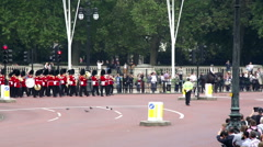 Buckingham Palace Changing of the guard entering Pall Mall Stock Footage