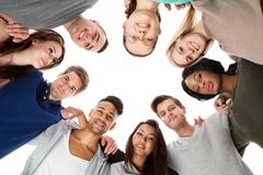 Confident college students forming huddle Stock Photos